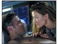 Solaris movie still: Chris Kelvin (George Clooney) and Rheya (Natascha McElhone) share a passionate moment amid the turmoil surrounding her shocking appearance aboard a space station in Solaris