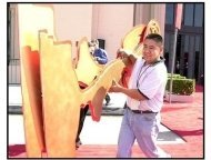 Emmy 2001 Cancellation: Rigo Guardado removes two of the Emmy decorations from the red carpet arrivals area