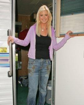 Tara Reid wearing TAG Jeans