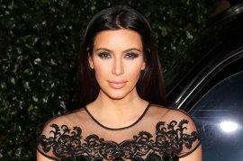Kim Kardashian Gives Away TCA Surfboard