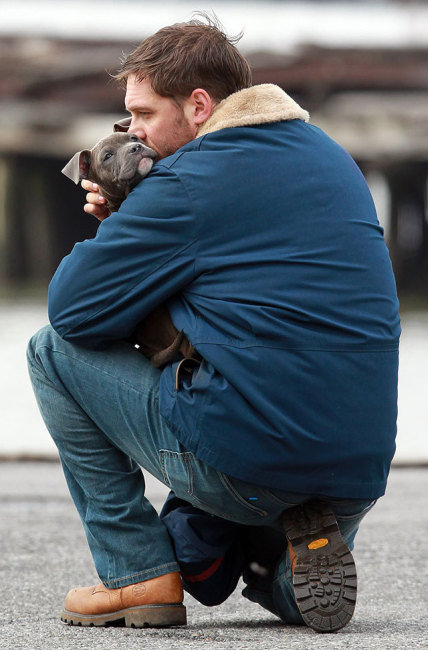 Tom Hardy Huddling with His Puppy