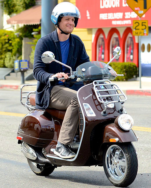 Jason Segel smiling on a scooter