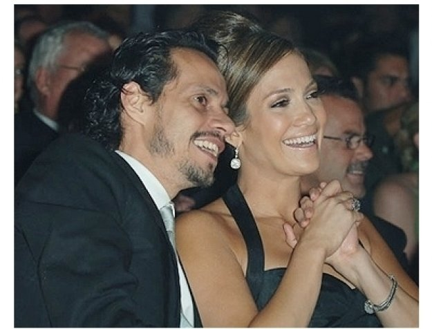 Marc Anthony and Jennifer Lopez watching the runway show