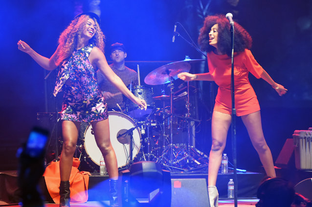 INDIO, CA - APRIL 12:  Singers Solange (R) and Beyonce perform onstage during day 2 of the 2014 Coachella Valley Music & Arts Festival at the Empire Polo Club on April 12, 2014 in Indio, California.  (Photo by Jeff Kravitz/FilmMagic)